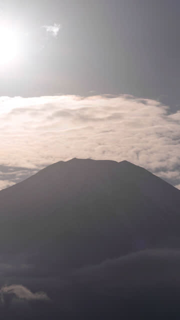 the sun setting towards mt. fuji with iridescent clouds (vertical/time lapse) - light natural phenomenon stock videos & royalty-free footage