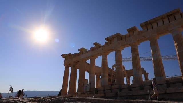 the sun shines above the parthenon temple at the acropolis on august 23, 2020 in athens. during the coronavirus pandemic, greece is restricting... - sun stock videos & royalty-free footage