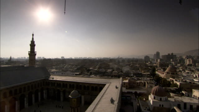 The sun shines above the walls of the Umayyad Mosque Damascus. Available in HD.