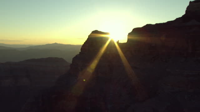 the sun shines down on the colorado river winding through the grand canyon. - mesa stock videos and b-roll footage
