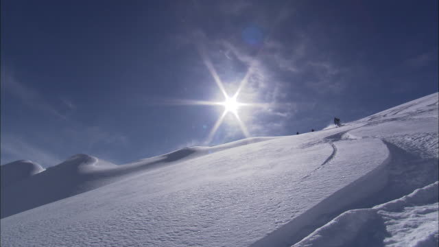 The sun shines on a downhill skier.