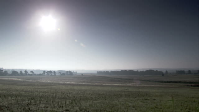 the sun shines over the east anglia countryside. available in hd. - east anglia stock-videos und b-roll-filmmaterial