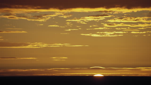 the sun sinks below the horizon of the sea - sea passage stock videos and b-roll footage