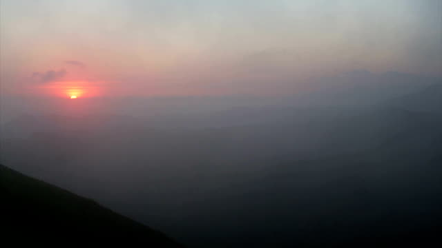 The sunrise over the lower Drakensburg mountains.South Africa