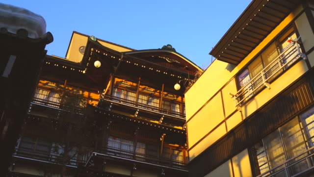 the sunset illuminates the japanese style ryokan (traditional japanese inn) kanaguya saigetsu at shibu onsen (shibu hot spring) yamanouchi-machi, nagano japan on feb. 17 2019. - inn stock videos & royalty-free footage