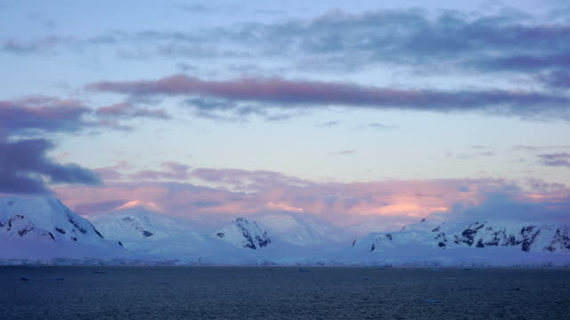 the sunset in the snowy mountains of antarctica - antarctica sunset stock videos & royalty-free footage