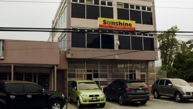 the sunshine newspaper building which is a weekly newspaper owned by former fifa vicepresident jack warner is seen on june 10 2015 in port of spain... - weekly stock videos and b-roll footage