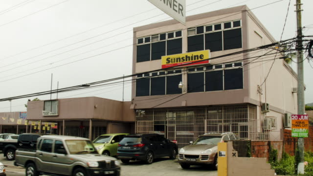 the sunshine newspaper building which is a weekly newspaper owned by former fifa vice-president jack warner is seen on june 10, 2015 in port of... - trinidad trinidad and tobago stock videos & royalty-free footage