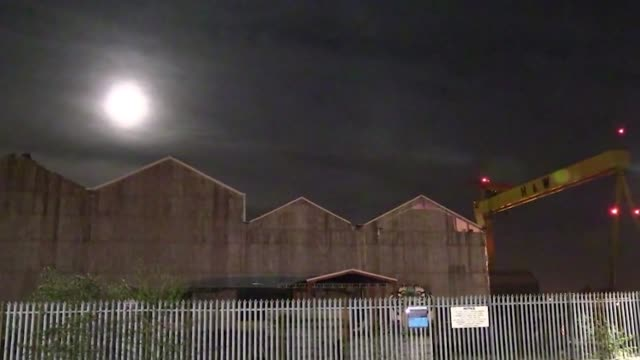 the supermoon is shown rising over dublin, over belfast from the harland and wolff cranes and from the titanic belfast museum and above liverpool's... - titanic belfast stock videos & royalty-free footage