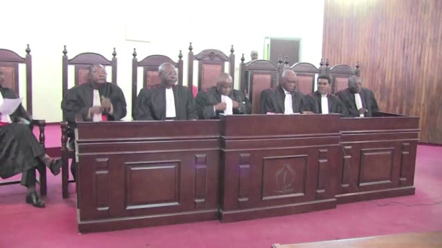 the supreme court in the democratic republic of congo held a new hearing in the 2010 murder by police of the countrys most prominent human rights... - court hearing stock videos & royalty-free footage