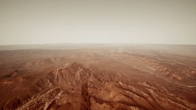 小さな岩と赤い砂が散らばった火星の表面 - 隕石孔点の映像素材/bロール