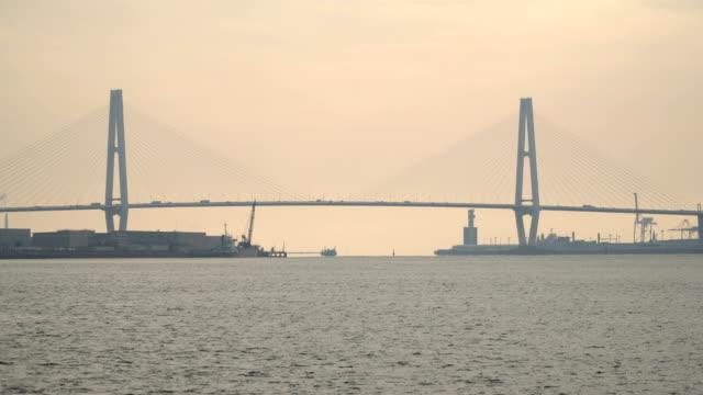 the suspension bridge around bay at sunset at nagoya, japan - suspension bridge stock videos & royalty-free footage