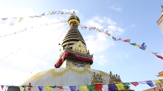 td of the swayambhunath temple also known as monkey temple with prayer flags and allseeing eyes of buddha in the northwest of the kathmandu valley in... - stupa stock videos & royalty-free footage
