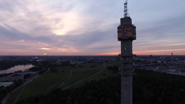 AERIAL: The Swedish TV-tower Kaknästornet at sunset