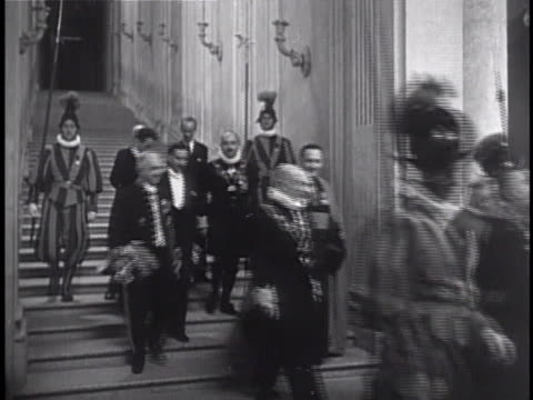 the swiss guard escorting guests dignitaries down staircase along hallway - swiss guard stock videos and b-roll footage