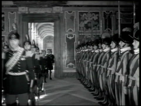 the swiss guard standing at attention as visitors in uniform walk down hallway king of italy vittorio emanuele iii queen elena walking down steps w/... - honour guard stock videos & royalty-free footage