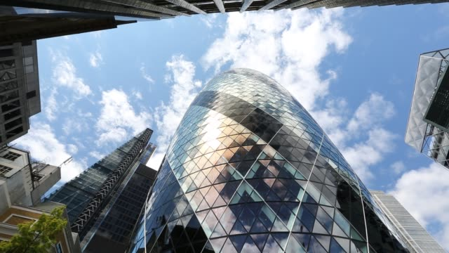 the swiss re tower and leadenhall building in the city of london, united kingdom. - diminishing perspective stock videos & royalty-free footage