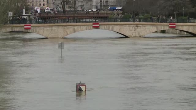 the swollen seine peaks at more than four metres above its normal level - île de france video stock e b–roll