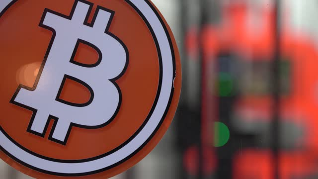 the symbol of the bitcoin is seen in front of a bitcoin atm machine placed within a safety cage on january 29, 2021 in barcelona, spain. the european... - cryptocurrency stock videos & royalty-free footage