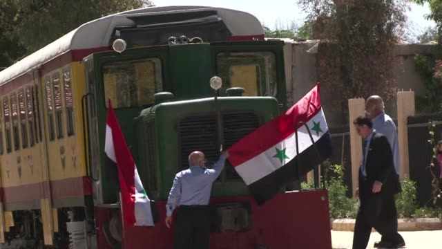 the syrian capital's tiny tourist train is returning puffs of hope to a city encircled by war with short trips to the greener suburbs of damascus - tourist train stock videos and b-roll footage