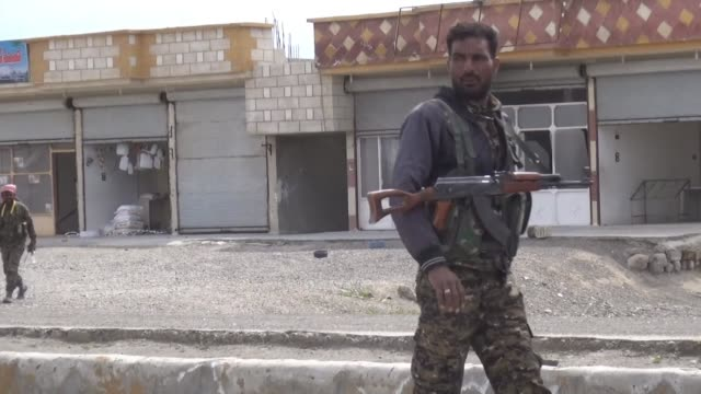 the syrian democratic forces an arab kurdish alliance backed by the us on sunday captured the village of al karamah from the islamic state group as... - syrian democratic forces stock videos & royalty-free footage