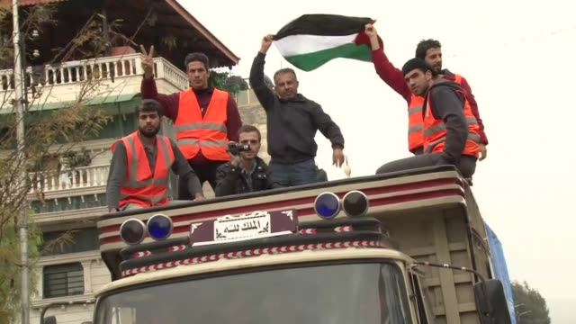 the syrian government and the palestine liberation organisation are negotiating an end a months long army siege of the yarmuk refugee camp in... - palestine liberation organisation stock videos & royalty-free footage