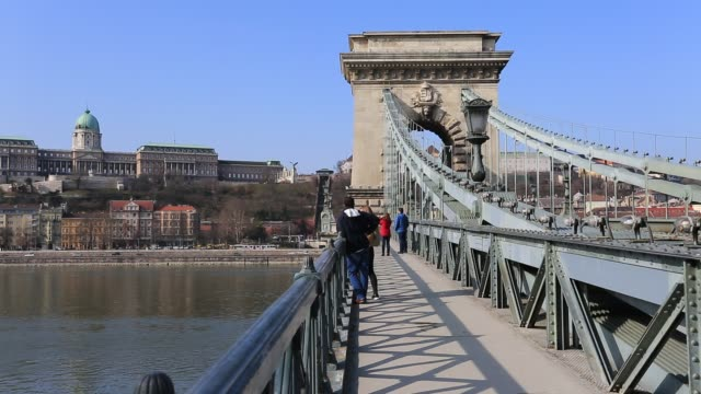 the szecheni lanchid suspension bridge ( chain bridge ), over the river danube between buda & pest cities, budapest city, hungary. - chain bridge suspension bridge stock videos & royalty-free footage