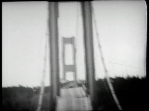 The Tacoma Narrows Bridge twists and buckles in high winds then collapses into the river