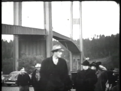 The Tacoma Narrows Bridge twists and buckles in high winds
