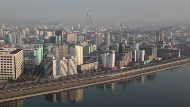the taedong river flows along the city of pyongyang. - pyongyang stock videos and b-roll footage