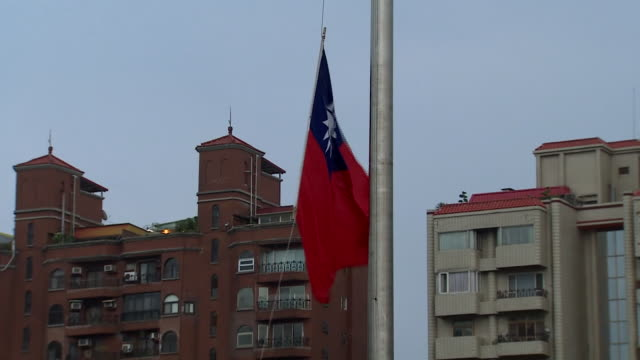 the taiwanese flag being lowered by a soldier in taipei - taiwanese flag stock videos & royalty-free footage