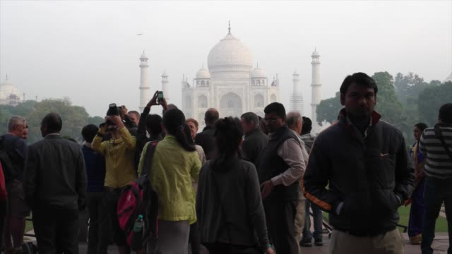 the taj mahal is regarded by many as the best example of mughal architecture and is widely recognised as the jewel of muslim art in india it is one... - agra stock videos and b-roll footage