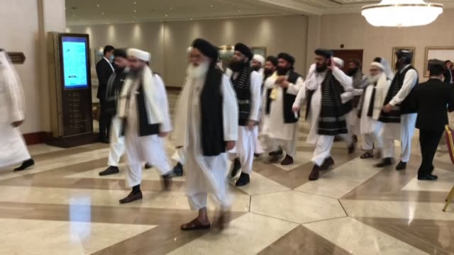 the taliban delegation arrives at a hotel in qatar's doha for peace talks with afghanistan's government in a bid to end nearly two decades of war - doha stock videos & royalty-free footage