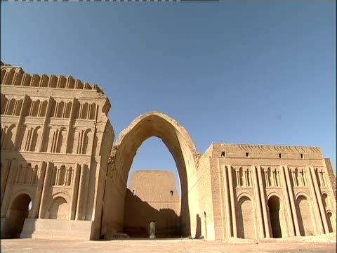the taq-e kisra arches over ruins at the ancient city of ctesiphon. - mesopotamia stock videos and b-roll footage