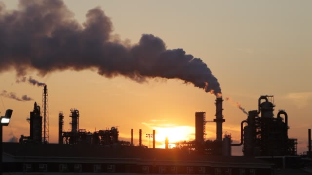 the tar sands upgrader plant at the syncrude mine north of fort mcmurray, alberta, canada, at sunset. the tar sands are the largest industrial... - oil stock videos & royalty-free footage