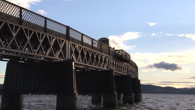 the tay rail bridge carries the mainline railway across the firth of tay between fife and dundee. it is a key artery on the london to aberdeen route.... - lorraine kelly stock videos & royalty-free footage