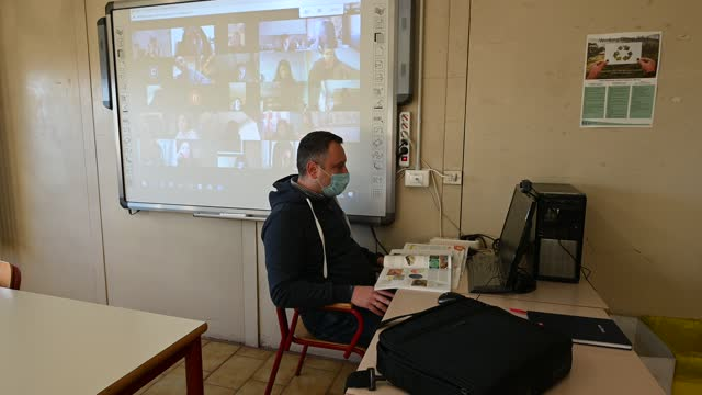 the teacher, wearing a mask, attends a remote lesson via google meet at the erasmus of rotterdam high school on november 23, 2020 in turin, italy.... - video call stock videos & royalty-free footage