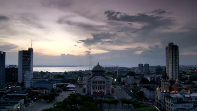 the teatro amazonas opera house stands among high-rise buildings in manaus, brazil. available in hd. - manaus stock videos and b-roll footage