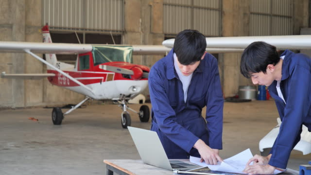 the technician planning and performs the aircraft repair inside the aircraft collector. - airplane hangar stock videos & royalty-free footage