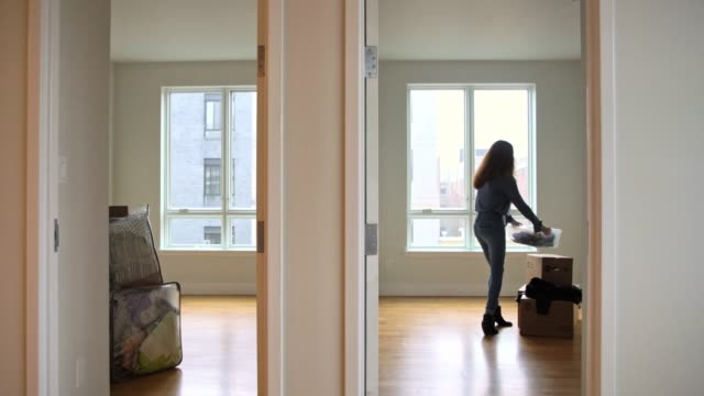 the teenager girl moving boxes into the empty new apartment - brooklyn new york stock videos & royalty-free footage