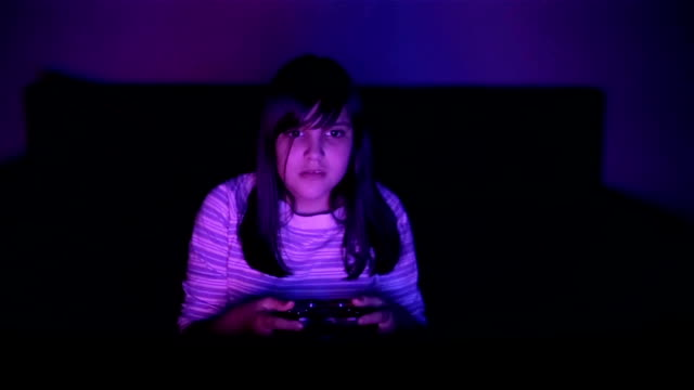 the teenager  girl plays the game late at night - leisure games stock videos & royalty-free footage