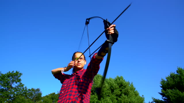the teenager girl practicing archery - archery bow stock videos and b-roll footage