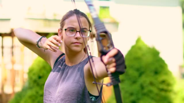the teenager girl practicing archery - only teenage girls stock videos and b-roll footage