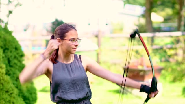 the teenager girl practicing archery - teenagers only stock videos & royalty-free footage