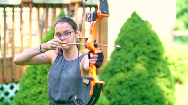the teenager girl practicing archery - only teenage girls stock videos & royalty-free footage