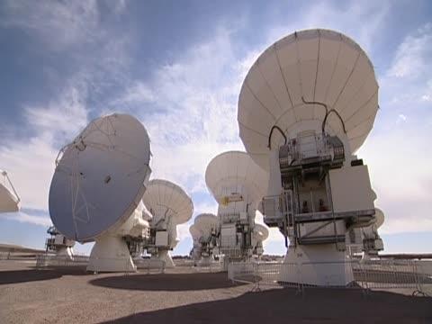the telescope alma's giant antennas high up in the atacama desert chile - atacama large millimeter array stock videos and b-roll footage