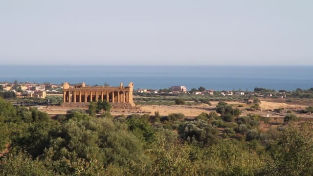 the temple of concord in the valley of the temples, overlooking the mediterranean at agrigento, sicily - 4th century bc stock videos and b-roll footage