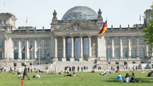 the text dem deutschen volke which mean to the german people stands inscribed over the main entrance of the reichstag seat of the bundestag germany's... - german flag stock videos & royalty-free footage