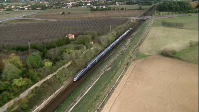 The TGV train moves across the countryside in France.