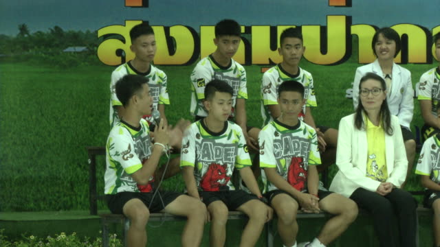 the tham luang boys speak at a press conference in chaing rai after being released from the hospital divers evacuated the 13 boys trapped in a... - chiang rai province stock videos and b-roll footage